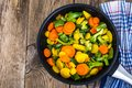 Carrots red and yellow, broccoli, beans in frying pan Royalty Free Stock Photo