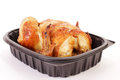 Carry out chicken dinner roast cooked and packaged by grocery store and brought home ready to serve still in plastic contain Stock Image