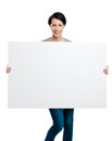 Carrying a huge sheet of white cardboard Stock Photos