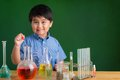 Carrying out experiment cute boy an in the science class Stock Photo