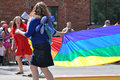 Carrying the pride flag women at edmonton s parade Royalty Free Stock Photo