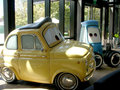 Cars animation characters from pixar studio film yellow car and blue truck Royalty Free Stock Photography