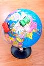 Cars around earth globe Stock Photo