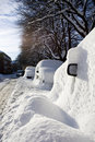 Cars buried in snow Stock Image