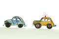 Cars chasing hand made toys Royalty Free Stock Photo