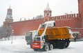 Cars clear snow on the Red Square. Snowstorm in Moscow Royalty Free Stock Photo
