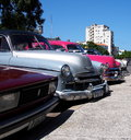 Cars of cuba restored vintage lined up in a parking lot in havana Royalty Free Stock Photos