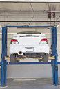 Cars on hoist at repair shop Stock Images