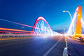 Cars light trails on the modern bridge at dusk Royalty Free Stock Image