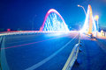 Cars light trails on the modern bridge at dusk Stock Photos