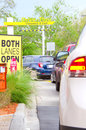 Cars in a long line at a drive thru restaurant Royalty Free Stock Image