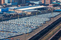 Cars new import export terminal photo image from high elevation of hundreds of manufactured car vehicles parked in harbor yards or Royalty Free Stock Photo