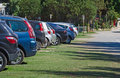 Cars parked in a parking lot on the grass Stock Photos
