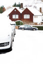 Cars parked in snow an english village england winter Royalty Free Stock Photos