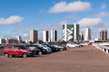 Cars parked in the street in brasilia brazil june row of parking lot on top of central bus station of city Stock Image