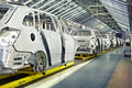 Cars in a row at car plant Royalty Free Stock Photo
