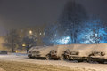 Cars in snow after snowstorm in night winter photography and snow calamity Royalty Free Stock Photo