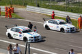 Cars and technicians on the grid at Monza circuit Royalty Free Stock Photo