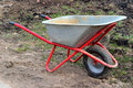 A cart for carrying heavy cargo in the garden spring Royalty Free Stock Image