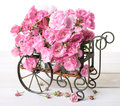 Cart of roses flower full pink old fashioned and peony flowers Stock Photo