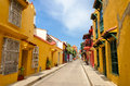 Cartagena street view typical scene in colombia of a with old historic colonial houses on each side of it Royalty Free Stock Images