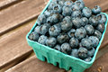 Carton box with fresh ripe blueberries outside Royalty Free Stock Images