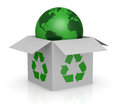 Carton box, recycling symbol and a earth globe Royalty Free Stock Photo