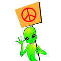 Cartoon alien with a placard in hand that shows peace sign Royalty Free Stock Image