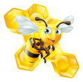 Cartoon bee and honey comb an illustration of a cute in front of Royalty Free Stock Photo