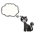Cartoon black cat with thought bubble Stock Photo