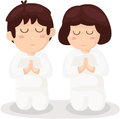 Cartoon boy and girl praying Stock Photos