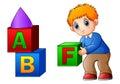 Cartoon boy playing with alphabet cubes