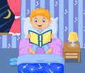 Cartoon boy reading bed time story Royalty Free Stock Photo