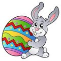 Cartoon bunny holding Easter egg Stock Image