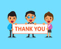 Cartoon business team holding thank you sign Royalty Free Stock Photo