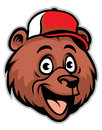 Cartoon cheerful bear head wearing a baseball cap