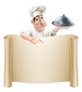 Cartoon chef pointing at menu a happy cook holding a silver platter or cloche a banner or Stock Images