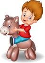 Cartoon child boy riding a toy donkey Royalty Free Stock Photo
