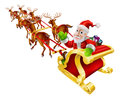Cartoon christmas santa claus sled illustration of flying in his or sleigh with reindeer and a sack of presents Royalty Free Stock Image