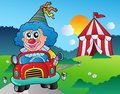 Cartoon clown in car near tent Royalty Free Stock Photos