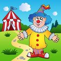 Cartoon clown with circus tent Royalty Free Stock Photos
