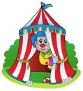 Cartoon clown in circus tent Royalty Free Stock Photo
