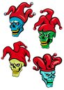 Cartoon clown and joker skulls or skull with hat bells eyes for halloween t shirt tattoo design Royalty Free Stock Image