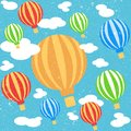Cartoon colorful balloons in blue sky with clouds. Seamless pattern