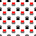 Cartoon dog paw prints - seamless pattern. Red heart on a white Royalty Free Stock Photo