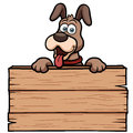 Cartoon dog with wooden sign vector illustration of Stock Photos