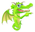 Cartoon dragon peeking round sign a drawing of a mascot a and pointing Royalty Free Stock Photography