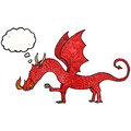 Cartoon dragon with thought bubble Royalty Free Stock Photography