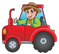 Cartoon farmer on tractor Stock Photo
