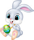 Cartoon funny easter bunny painting an egg illustration of Royalty Free Stock Images